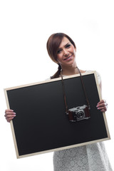 Young Woman Holding Board with Camera around Neck