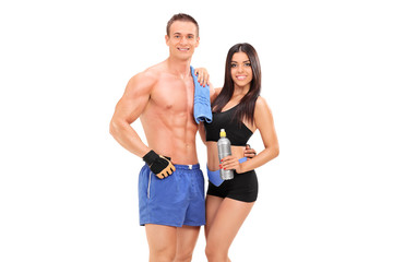 Athletic couple posing with water bottle