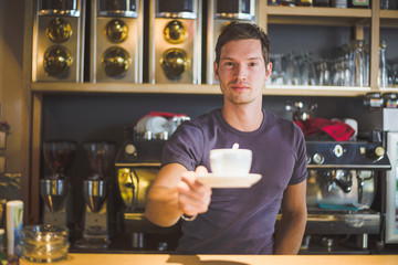 Waiter holding coffee cup