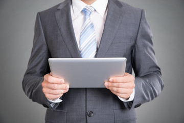 Businessman hands holding tablet computer