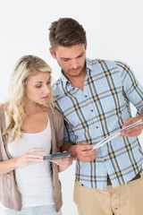 Concentrated young couple with bills and calculator