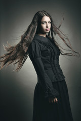 Beautiful dark girl with long flying hair