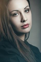 Dark colors portrait of beautiful woman