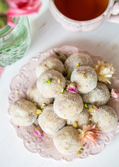 Homemade coconut balls decorated with little pink flowers