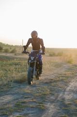 Rider on sport bike for enduro on motocross track