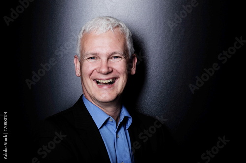 canvas print picture man laughing blue background
