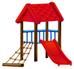 A toy house at the park with a slide