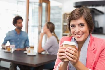 Pretty brunette enjoying her coffee