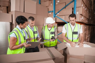 People at work in warehouse