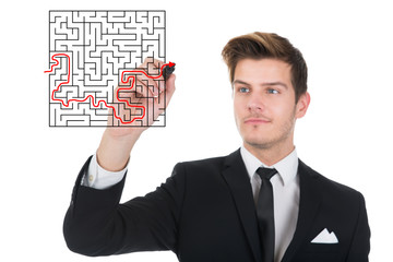Businessman Solving Maze Puzzle On Transparent Screen