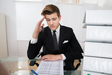 Worried Businessman Reading Document