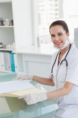 Smiling doctor holding a medical file