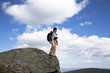 Male photographer on a cliff