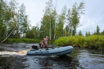 Hunter in motor boat