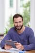 canvas print picture - glücklicher mann mit bauplänen und tablet