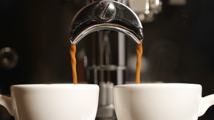 espresso being poured from a proffesional espresso machine