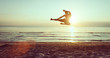 flying kick on the beach