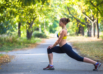 Fitness woman doing stretching during workout