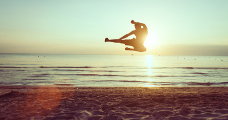 flying kick on the beach