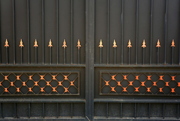 Forged metal gate as a backdrop