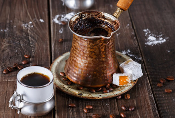Turkish coffee over dark wooden background