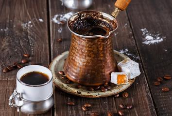 Turkish coffee over dark wooden background