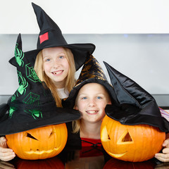 Two girls with halloween pumpkins