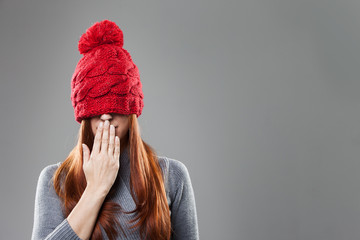 Woman Covering Eyes with Red Bonnet