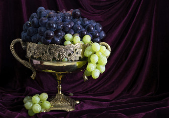 Still life with blue and green grape