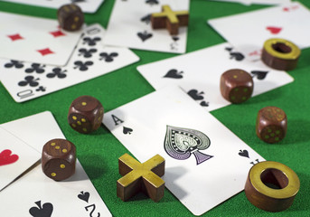 Cards, tic-tac-toe and dice on green background