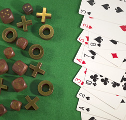 Gambling theme with cards, dice and tic-tac-toe