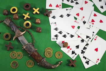 Gambling theme with knife and cards