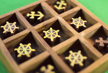 Wooden tic-tac-toe game in the box