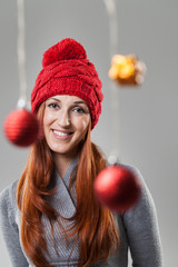 Smiling Pretty Woman in Gray Suit and Red Bonnet