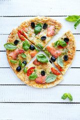 pizza with trout and tomatoes