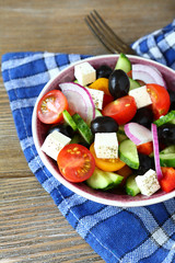 appetizing vegetable salad with olives and cheese
