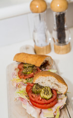 Fresh Italian Sub Sandwich with Salt and Pepper Shakers