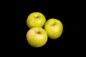 Three Granny Smith Apples on Black Background