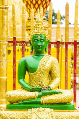 Green Buddha image on sitting position