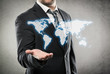Businessman with open palm showing world map