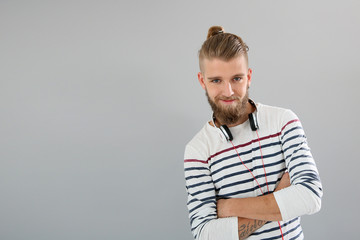 Portrait of cheerful trendy guy with stiped shirt