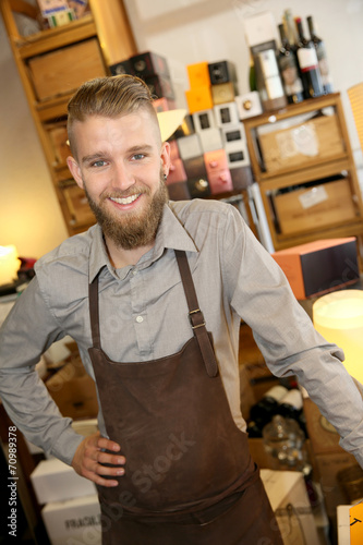 canvas print picture Man working in wine shop