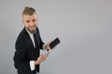 Young businessman using smartphone, isolated