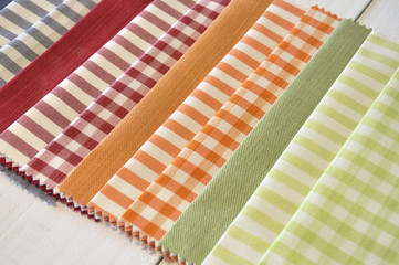 Several fabrics of different patterns and colors
