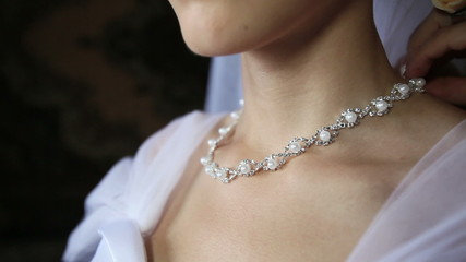 bride necklace of pearls in a silver frame