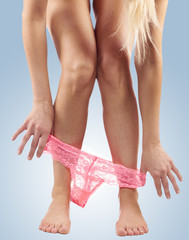 Sexy legs pulling panties down.