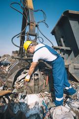 Worker in a junkyard