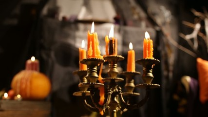 Halloween Candlestick. Candles Tremble