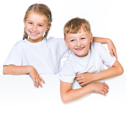 boy and girl behind white banner