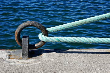mooring ring on dock with rope